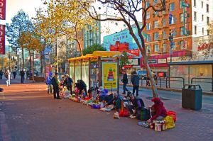 The sidewalk commerce that now occurs on Market Street--incuding these Asian women who frequently sell scavenged goods--suggests its potential as a future cafe space.